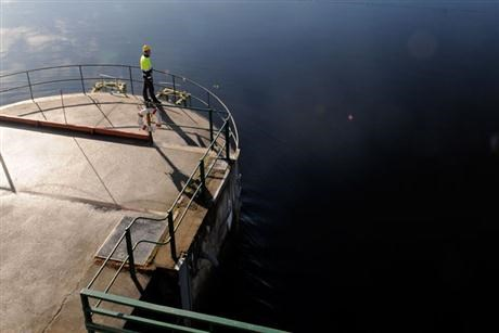 Man standing on Kvistforsen powerplant intake